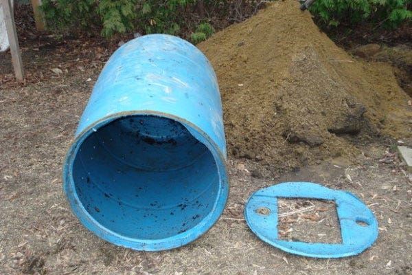 this dog poop composter is a simple solution to a dog yard clean up